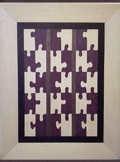 Bild aus Holz mit Puzzleteilen